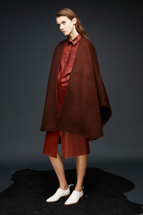 red winter poncho look