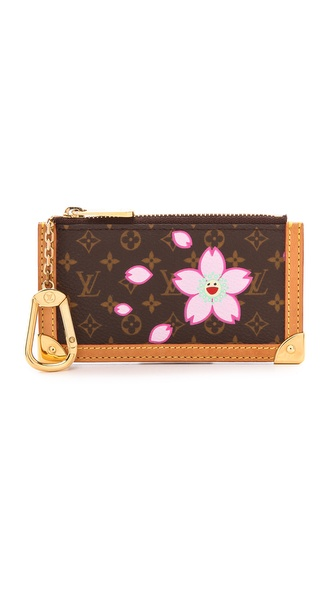 lv murakami coin purse in a flower adorned monogram pattern