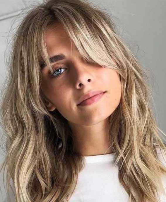 trendy blond women's gypsy shag haircuts