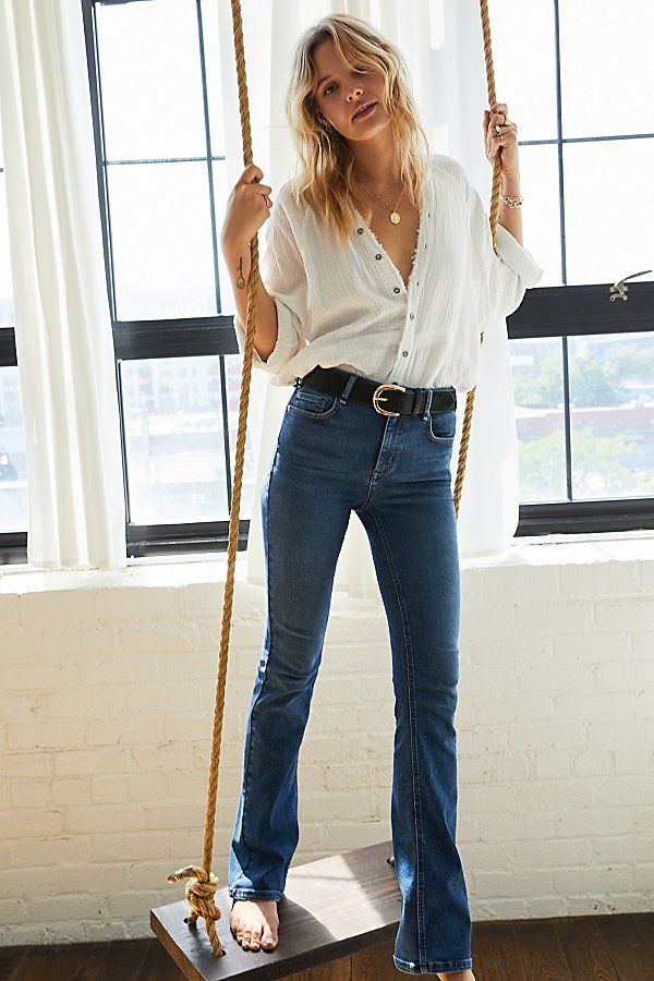 women's outfit with bootcut jeans and white shirt