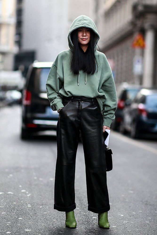 women's casual chic outfit for fall winter with leather pants boots and sweatshirts