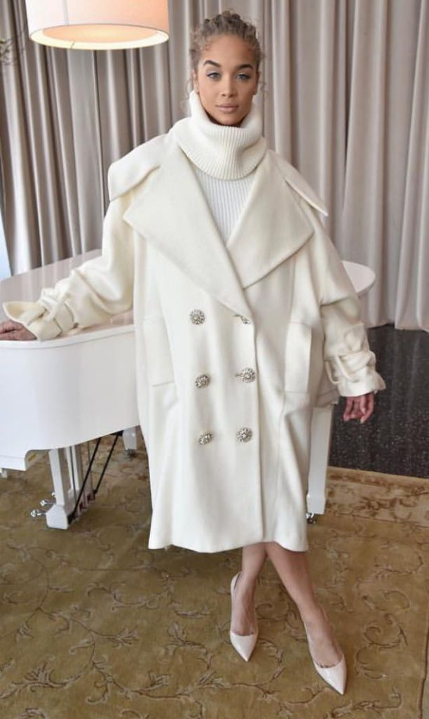 women's winter chic outfit with white coat